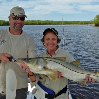Capt Pete Rapps with Zaida and her first ever Snook which was released after this photo