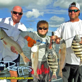 Jack Apgar, Grandson Jack, and Son Chris with a fine catch on a recent Captain Rapps Charter copy