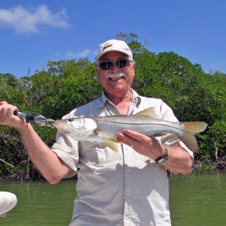 Jon J with a nice juvenile Snook caught with a live pilchard on a Captain Rapps Charter