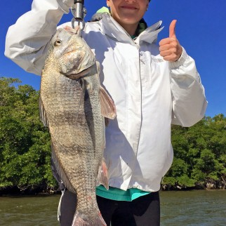 Katelyn Parrish with a black drum caught on a recent Capt Rapps charter