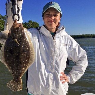 Katelyn Parrish with a flounder caught on a recent Capt Rapps charter