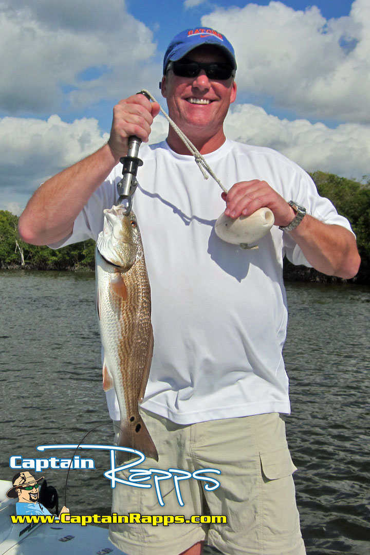 Brian olson with a redfish on a Captain Rapps Chokoloskee Fishing Charter