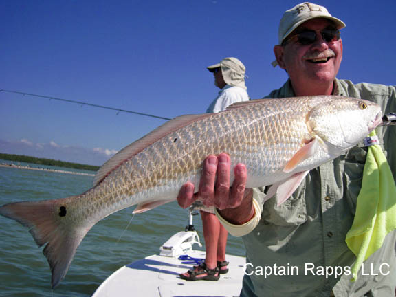 Ken with a nice Redfish with Captain Rapps Chokoloskee and everglades city fishing charters