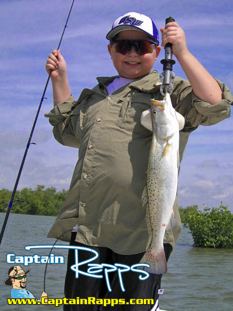 Ronnie with a chokoloskee Spotted sea trout on a captain rapps charter