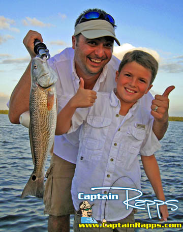Greg scalogna and Joey with a Redfish on a Captain Rapps chokoloskee charter